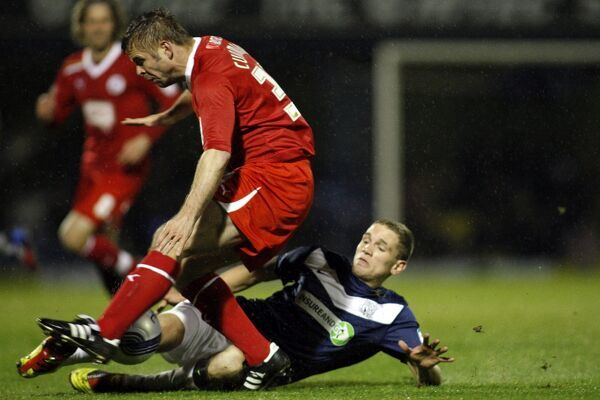 Lee Sawyer (Southend United) makes a tackle on Warren Cummings (Crawley Town) - Southend United vs. Crawley Town - npower League Two at Roots Hall, Southend - 05/03/12 - Mandatory Credit: Pixel8 Photos/David Scriven - +44(0)7734 151429 - info@pixel8photos
