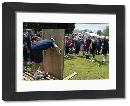Ryan Hall takes aim at Barry Corr in the stocks - Meet the Blues Day at Boots and Laces, Southend - 15/07/12 - Mandatory Credit: Pixel8 Photos/David Scriven - 0 - - NO UNPAID USE