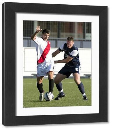 Graham Coughlan (Southend United) holds onto Nesa (Rayo Vallecano B) - Rayo Vallecano B vs