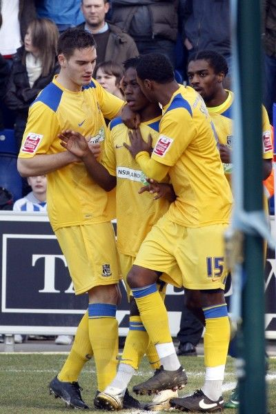 Coca-Cola League One - Colchester United vs. Southend United Southend United goalscorer Franck Moussa (centre) is hugged by Dorian Dervite (left) and Osei Sankofa (right) following his goal. Credit: David Scriven
