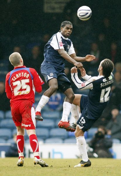 Anthony Grant (Southend United) rises highest over team-mate Damian Scannell (Southend United) and Adam Clayton (Carlisle United) - Southend United vs. Carlisle United 20/03/10 - Mandatory Credit: Pixel8 Photos/David Scriven
