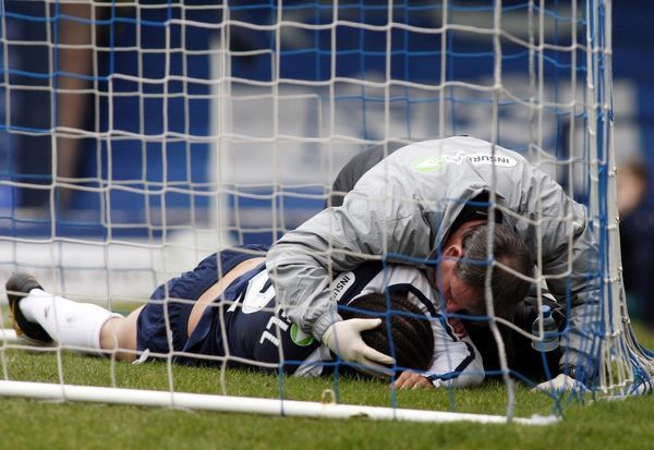 Damian Scannell (Southend United) receives treatment from physio John Stannard in the goal net following Adam Barrett's goal - Southend United vs. Carlisle United 20/03/10 - Mandatory Credit: Pixel8 Photos/David Scriven