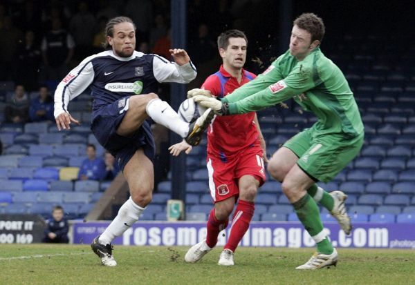 Damian Scannell (Southend United) collides with keeper Adam Collin (Carlisle United) - Southend United vs. Carlisle United 20/03/10 - Mandatory Credit: Pixel8 Photos/David Scriven