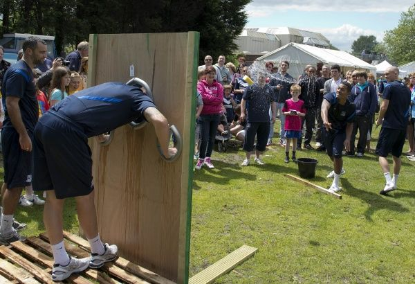 Ryan Hall takes aim at Barry Corr in the stocks - Meet the Blues Day at Boots and Laces, Southend - 15/07/12 - NO UNPAID USE