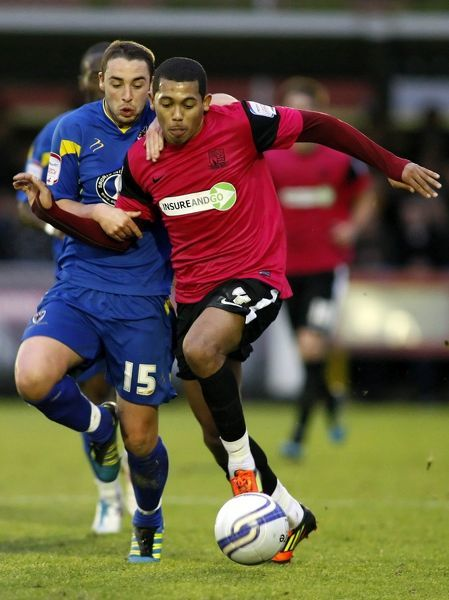 Ryan Hall (Southend United) holds off Sammy Moore (AFC Wimbledon) - AFC Wimbledon vs. Southend United - npower League Two at The Cherry Red Records Stadium, Kingston upon Thames - 31/12/11 - NO UNPAID USE