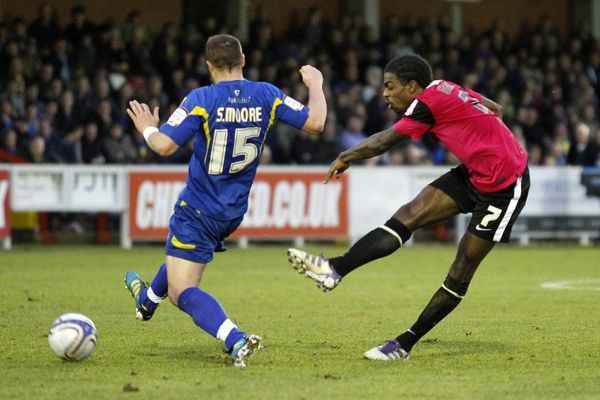 Anthony Grant (Southend United) shoots from distance as Sammy Moore (AFC Wimbledon) closes in - AFC Wimbledon vs. Southend United - npower League Two at The Cherry Red Records Stadium, Kingston upon Thames - 31/12/11 - NO UNPAID USE