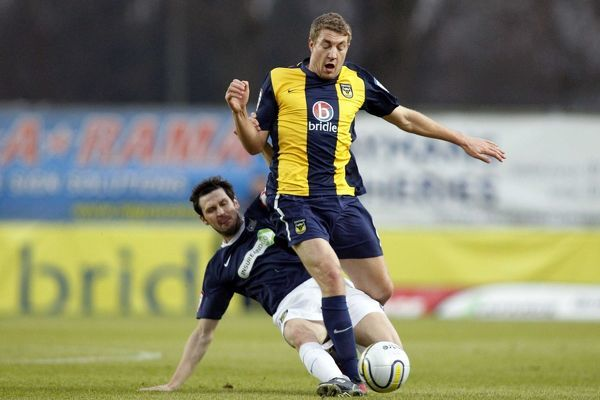 Craig Easton (Southend United) tackles Simon Heslop (Oxford United) - Oxford United vs. Southend United - npower League Two at Kassam Stadium, Oxford - 01/01/11 - NO UNPAID USE