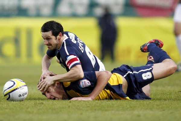 Craig Easton (Southend United) gets to grips with Simon Heslop (Oxford United) - Oxford United vs. Southend United - npower League Two at Kassam Stadium, Oxford - 01/01/11 - NO UNPAID USE