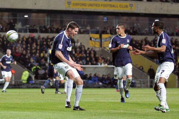 Barry Corr (Southend United, left) celebrates his goal with Louie Soares (Southend United) - Oxford United vs