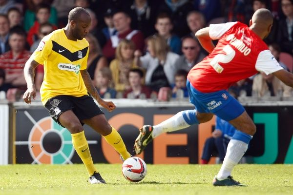 Anthony Straker (Southend United) takes on Lanre Oyebanjo (York City) - York City vs. Southend United - npower League Two at Bootham Crescent, York - 20/04/2013 - Mandatory Credit: Pixel8 Photos/Phil Cook