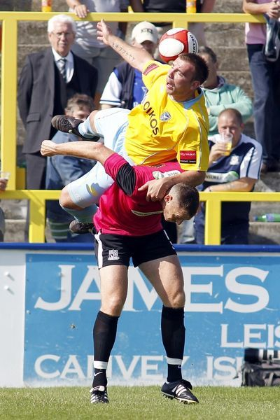 Jason Hallett (Canvey Island) takes a ride on the back of Graham Coughlan (Southend United) - Canvey Island vs. Southend United XI - Pre-Season Friendly at Park Lane, Canvey - 30/07/11 - NO UNPAID USE