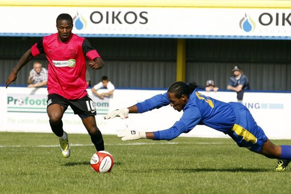 Kyle Asante (Southend United) tries to go round the keeper - Canvey Island vs. Southend United XI - Pre-Season Friendly at Park Lane, Canvey - 30/07/11 - NO UNPAID USE